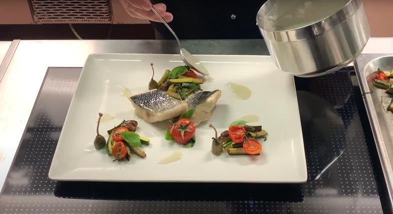 Sea bass fillet with Mediterranean flavors